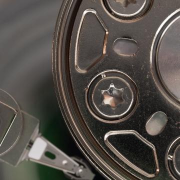 A close-up of a broken hard drive.